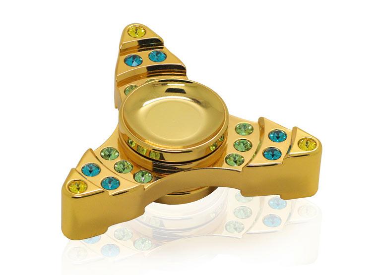 fidget spinner med guld og sten
