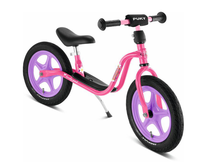 lyserød løbecykel